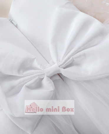 Delicate double lace christening dress with a big bow on the back